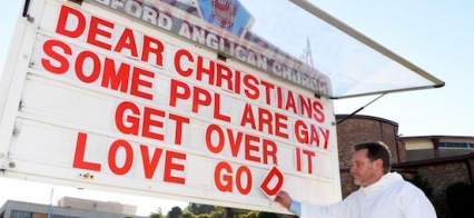 Father Rod Bower outside the Anglican Parish of Gosford, with the gay rights sign that has gone viral, with thousands of Facebook shares and likes.